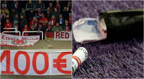 Phản đối giá vé đắt đỏ, fan Bayern ném tiền giả xuống sân